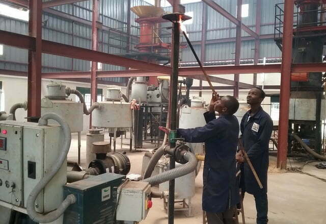 Engineers at Nyabyeya Forestry College's Biomass Gasification plant.