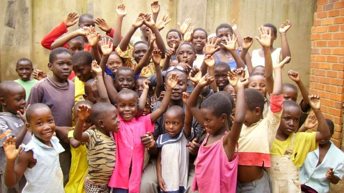 Oasis of Life Orphanage children happy after receiving donations of clothing and other necessities from visiting guests - File Photo