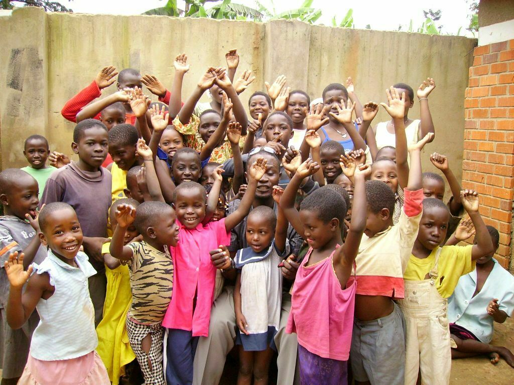 Oasis of Life Orphanage children happy after receiving donations of clothing and other necessities from visiting guests