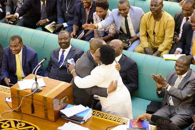 MPs hug on the floor of parliament