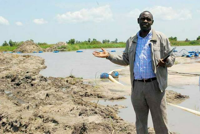 Alex-Byarugaba-the-Parliamentary-natural-resources-committee-chairperson-at-one-of-the-sand-ditches-in-Lwera-wetland