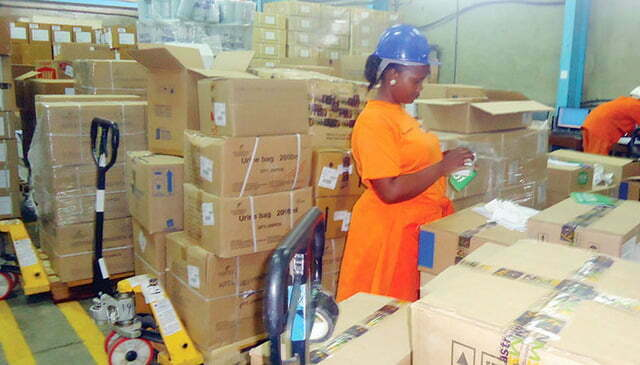 National Medical Stores staff inspecting medicines