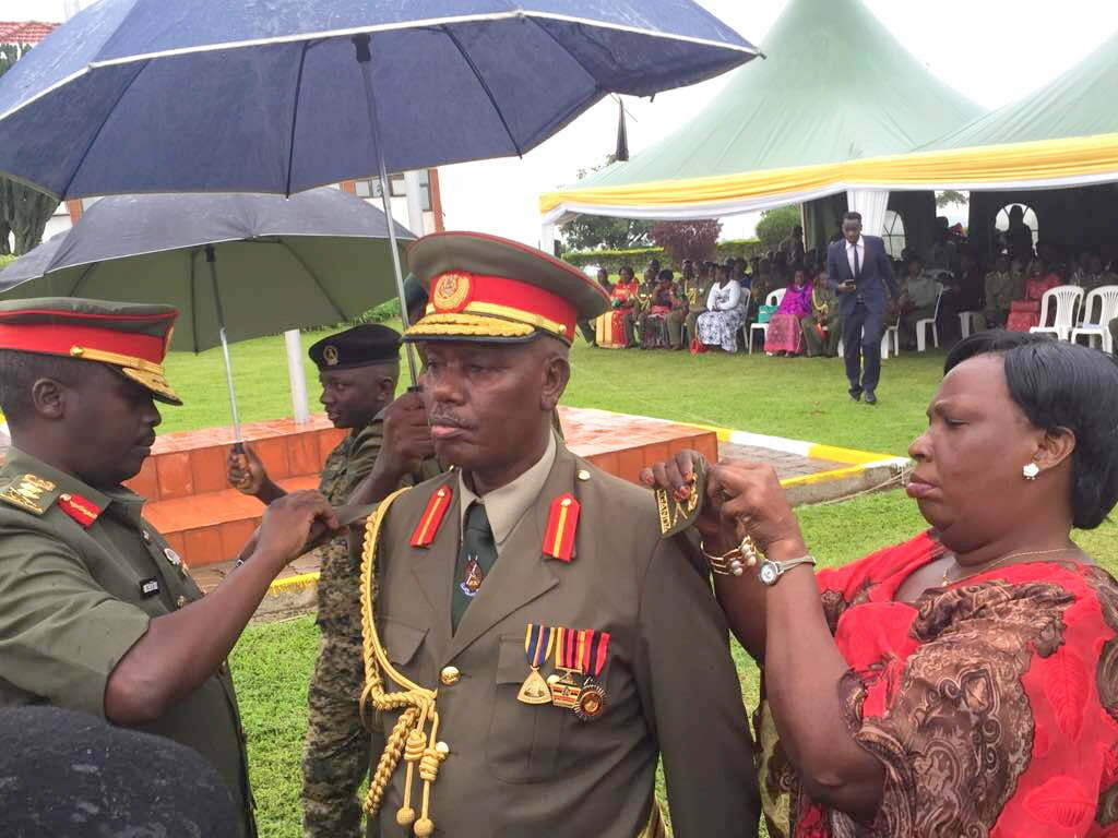 Major General Stephen Rwabantu Tumusiime the Deputy commander Reserve Forces Is decorated by CDF David Muhoozi and his wife