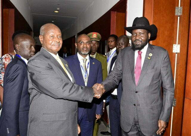 President Museveni shaking hand with his counterpart Salva Kiir