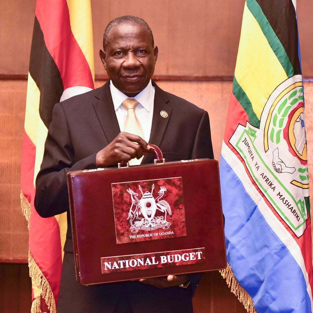 Finance Minister Matia Kasaija displaying the budget for the coming financial year 2018-2019