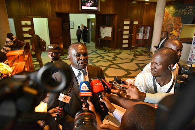 Justice Owiny Dollo talking to media at Parliament of Uganda
