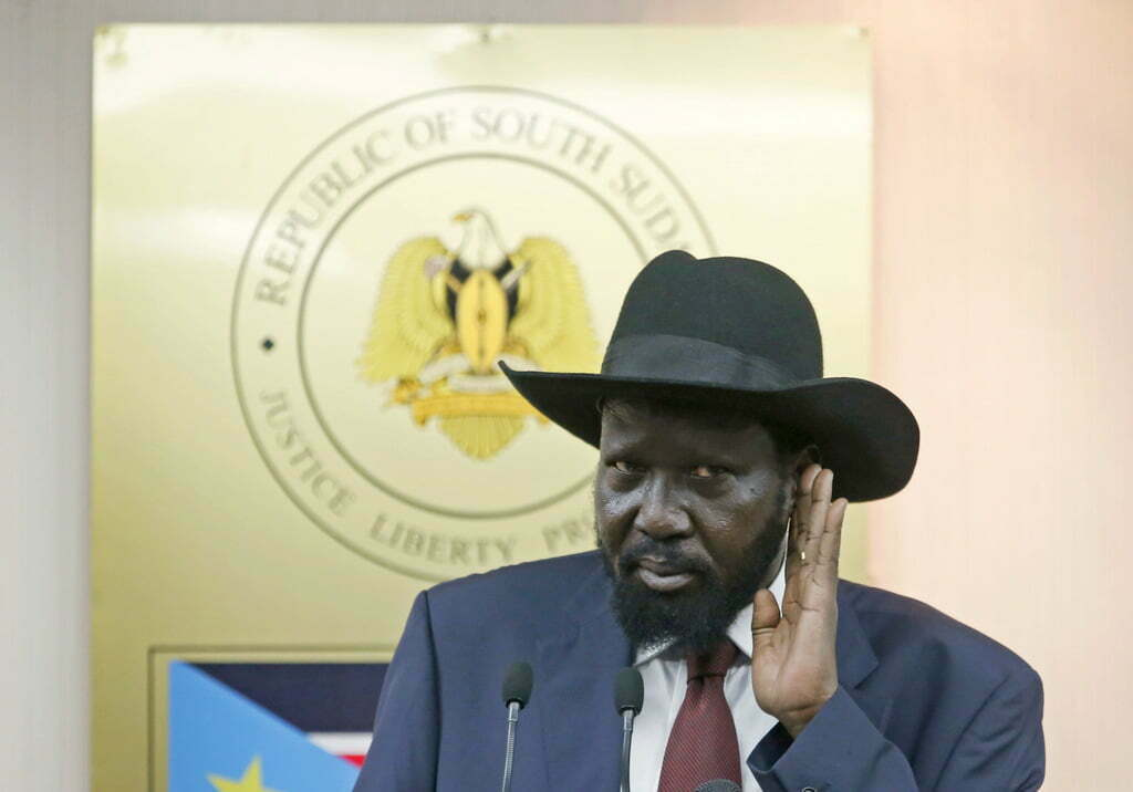 South Sudan's `president Salva Kiir listen media questions during a news conference in Juba