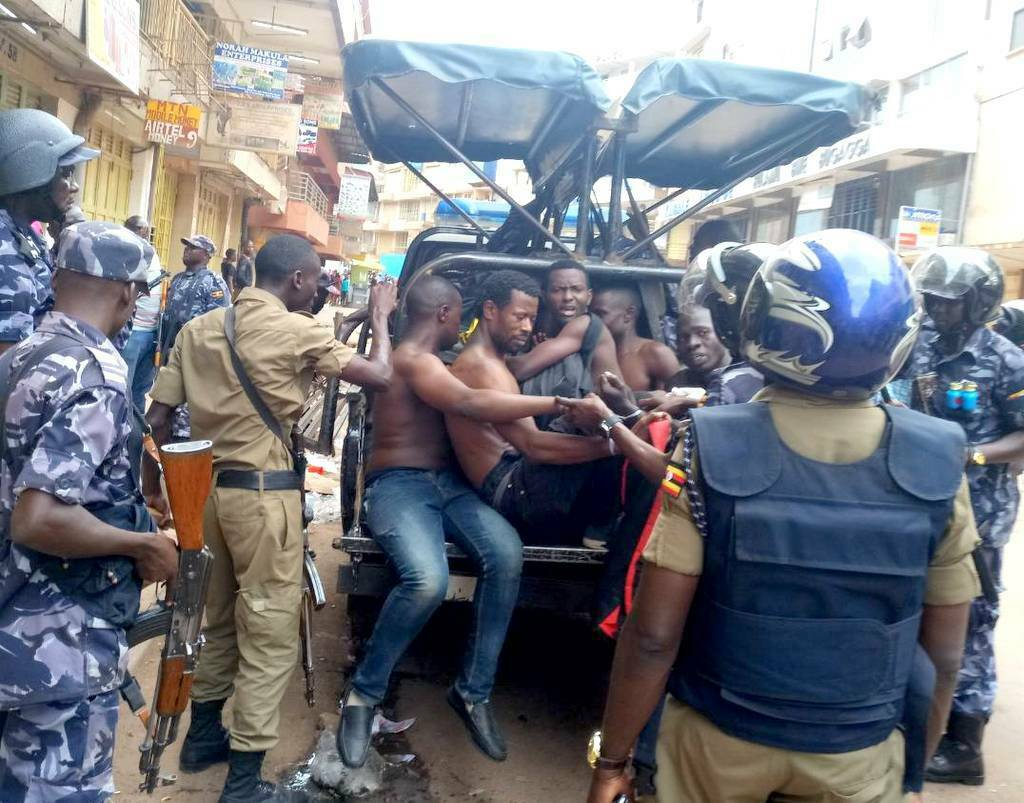 Ugandan security forces briefly beat then detain a protesters in Kampala, Uganda, Monday, Aug. 20, 2018.