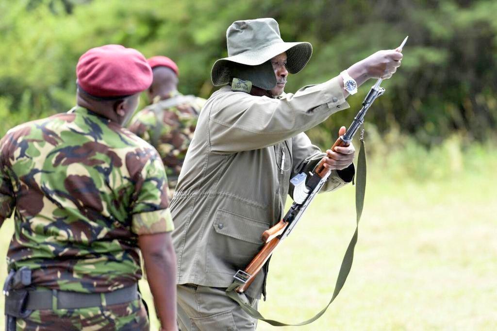 President Museveni at a shooting range drill at Kyankwanzi