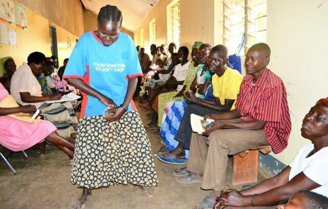 A Karamojong woman demonstrates the use of a female condom