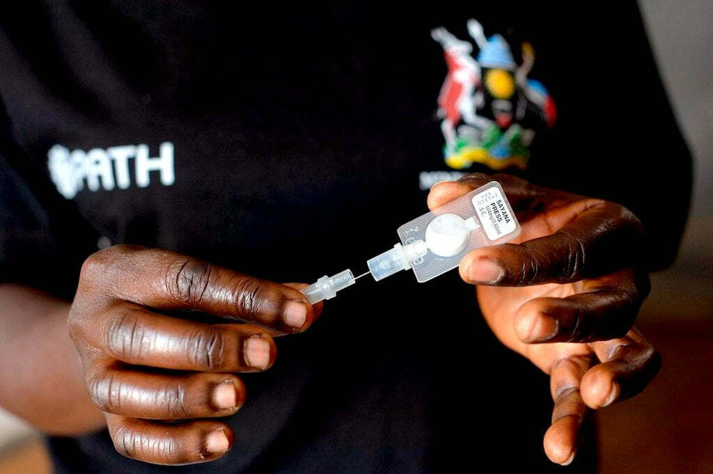 Community health worker holds subcutaneous DMPA device