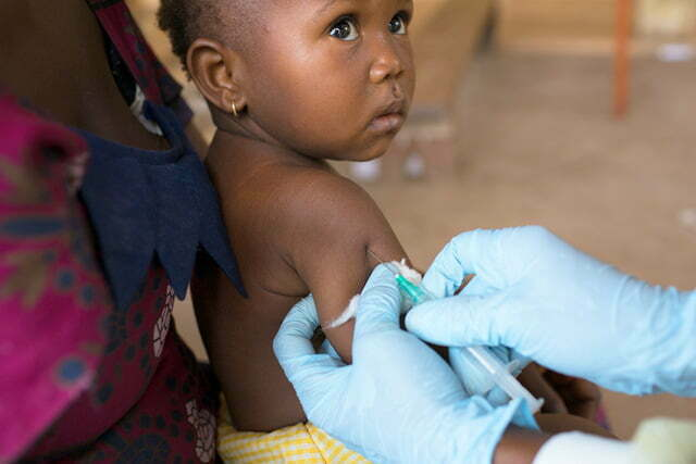 Young child receiving a measles immunisation