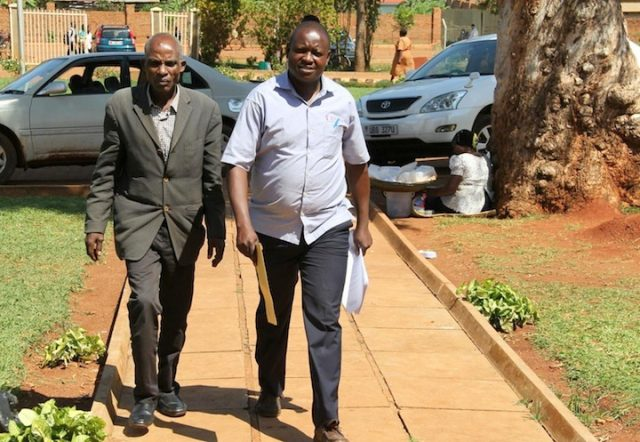 Witch doctor Damian Akuze (L) at arriving at Jinja High Court
