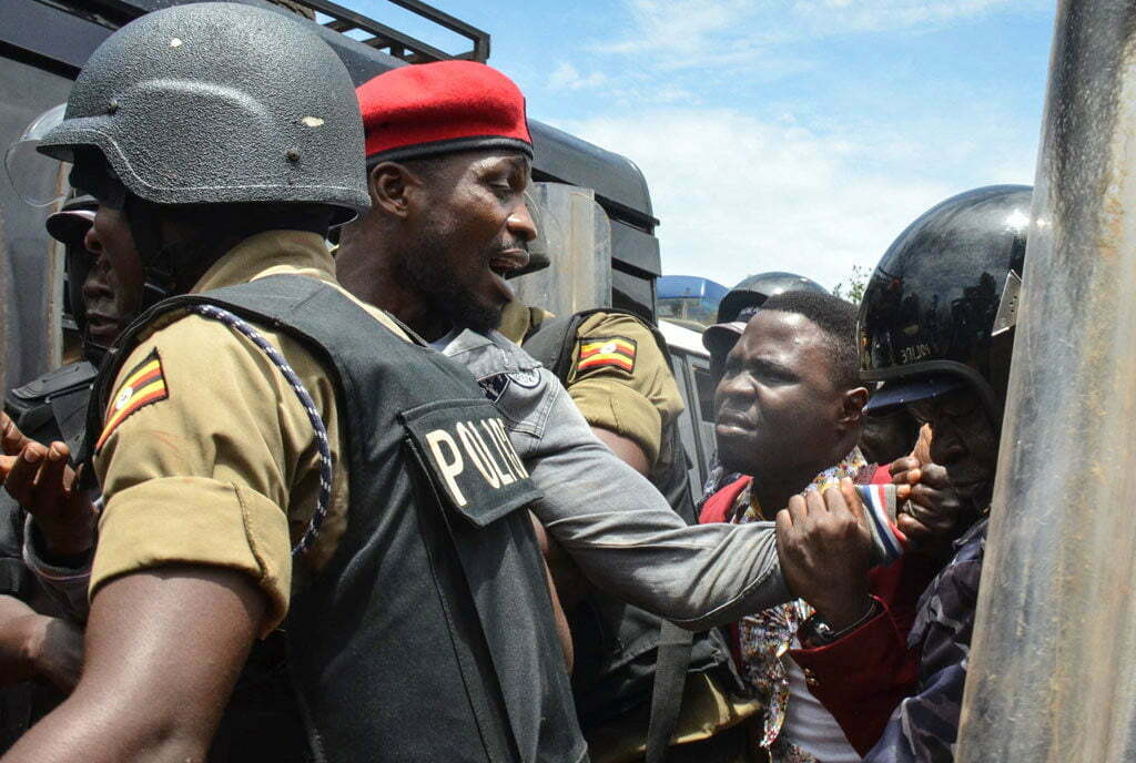 Bobi Wine being arrested after Police blocked his concert in Busabala