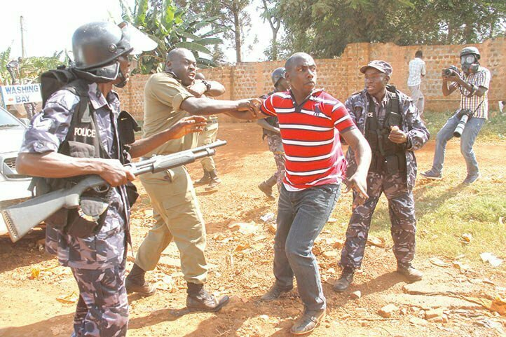 Christopher-Aine–in-Red–battling-police–in-Jinja-late-last-year