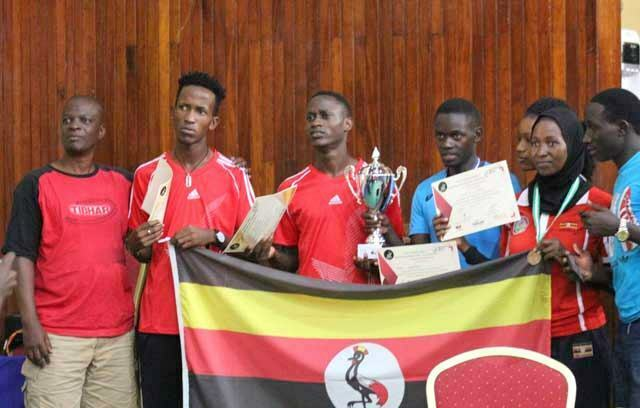Team Uganda Players with Head Coach, Jude Mutete, Eddy Omongole and Amina Lukaya donning their medals