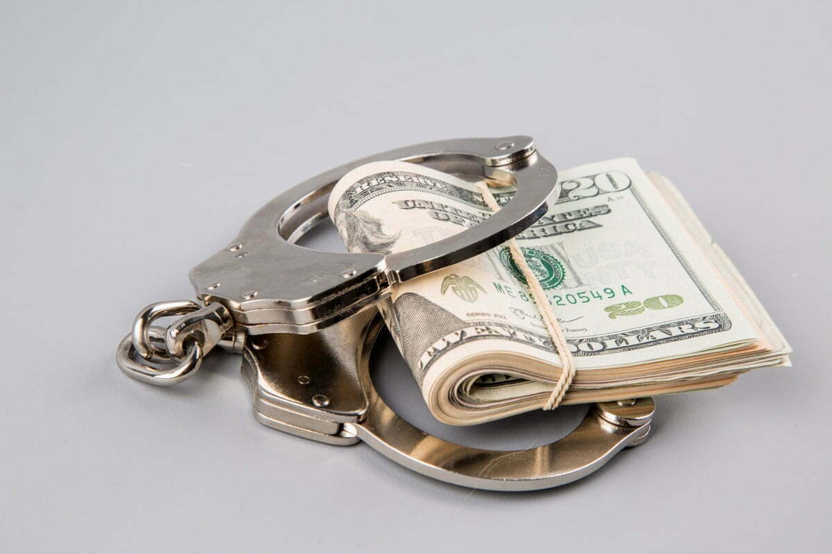 handcuffs-and-dollars