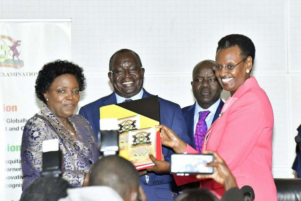 Minister Janet Museveni (right) together with UNEB and Ministry officials release results last week. The ministry wants to change the way students are examined in a new curriculum