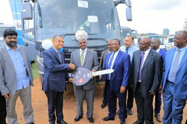 Hon.Sam Kutesa receives a fleet of 88 Motor Vehicles donated by the Government of India