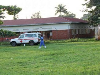 ambulance parked outside COVID-19 isolation center in Jinja