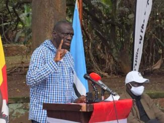 Dr. Kizza Besigye addressing FDC delegates and media