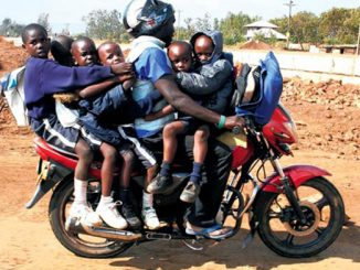 Boda boda rider with school kids