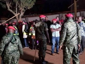 Military police officers ordering NUP members to vacate Ssebaggala's vigil premises