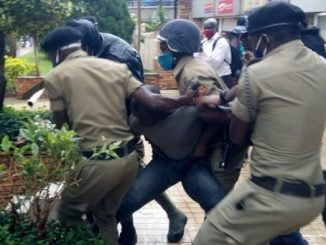 Police arresting one of Bobi Wine's bodyguards
