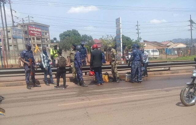 Police officers clear debris from the road