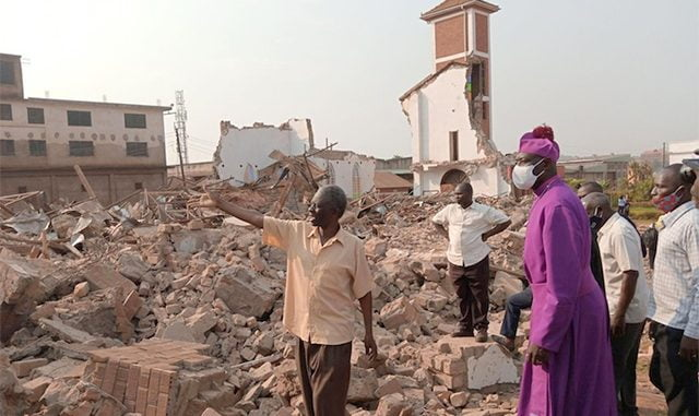 Bishop-and-church-goers-at-demolition-site