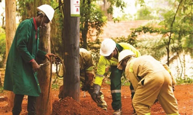Umeme-engineers-connecting-electric-pole