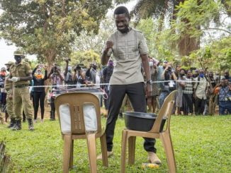 Bobi Wine casting his ballot