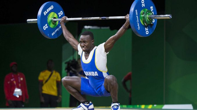 Ugandan weightlifter who fled Olympics camp returns home